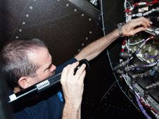 Commander Chris Hadfield installs the<br /> redundant Ku Communications 1 unit in<br /> Destiny to complete the refurbishment<br /> of the Ku system aboard the<br /> International Space Station.<br /> Credit: NASA<br /> <br /> <br />